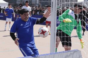 """Maradona recreates """"hand of God"""" moment in South Korea"""