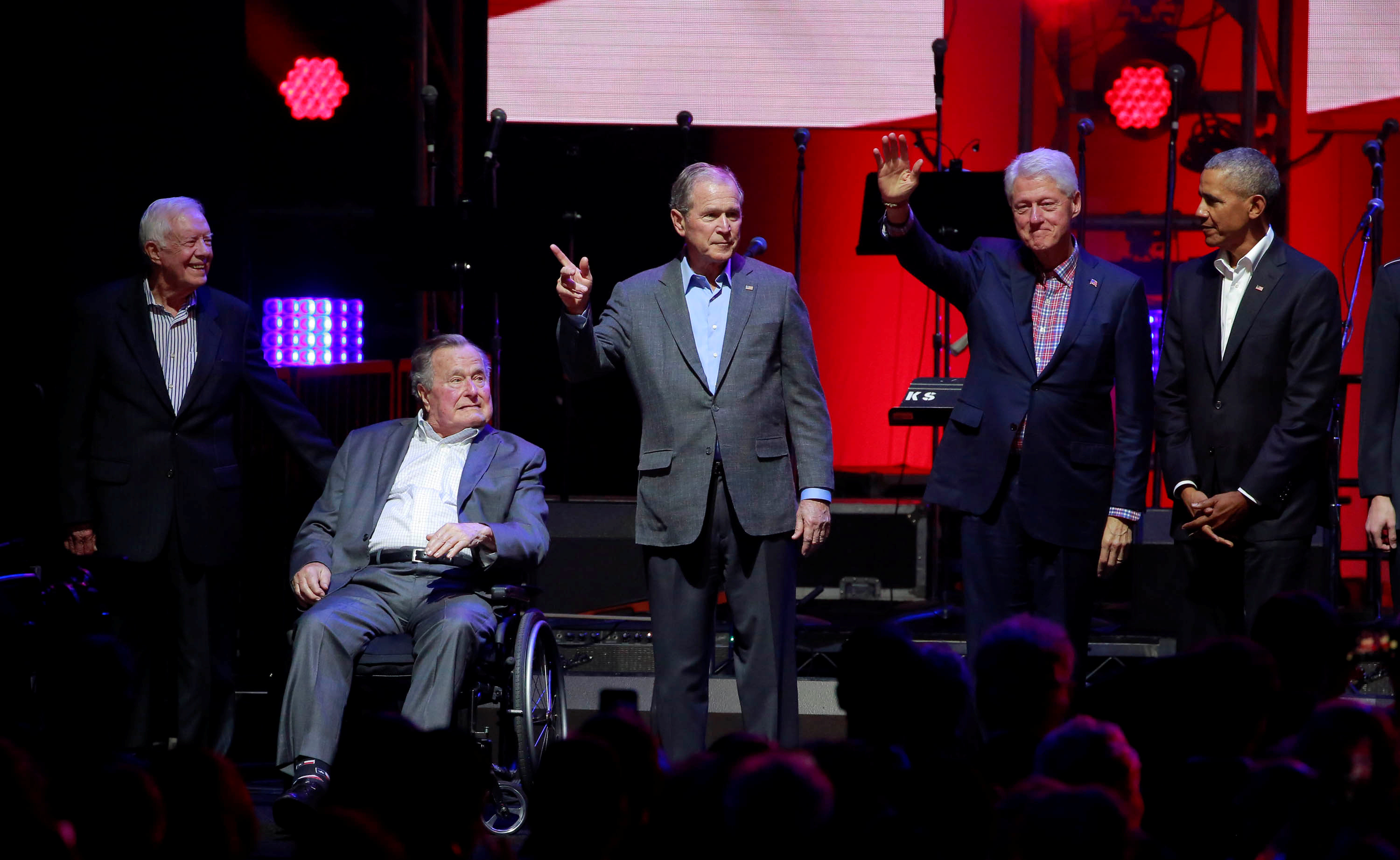 Five former U.S. presidents, Jimmy Carter, George H.W. Bush, Bill Clinton, George W. Bush, and Barack Obama attend a concert at Texas A&M University benefiting hurricane relief efforts in College Station, Texas, U.S., October 21, 2017.   REUTERS/Richard Carson