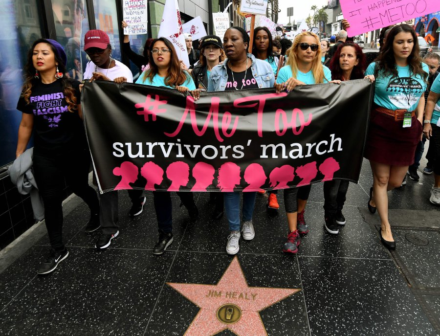 Women who are survivors of sexual harassment, sexual assault, sexual abuse and their supporters protest during a #MeToo march in Hollywood, California on November 12, 2017. Several hundred women gathered in front of the Dolby Theatre in Hollywood before marching to the CNN building to hold a rally. / AFP PHOTO / Mark RALSTON