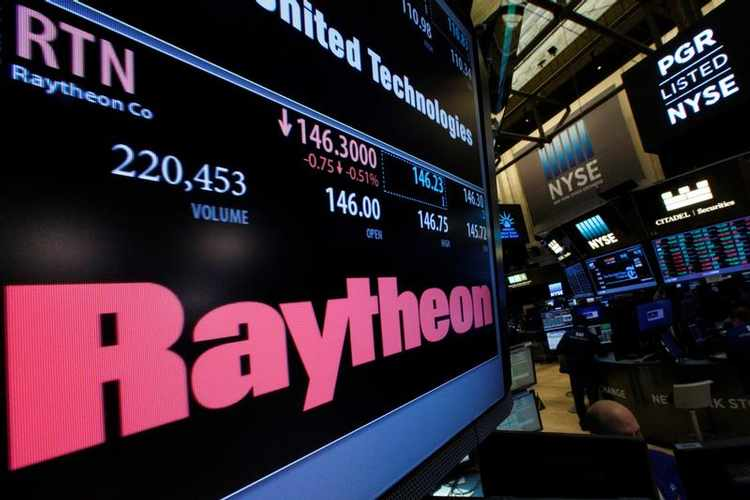 A screen displays trading information for Raytheon on the floor of the New York Stock Exchange (NYSE) in New York City, U.S., January 24, 2017.  REUTERS/Brendan McDermid - RTSX5W5