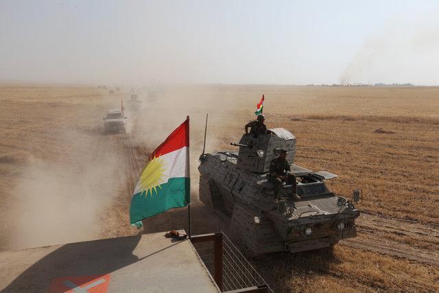 A Kurdish flag is seen on military vehicles of the Kurdish Peshmerga forces on the southeast of Mosul, Iraq, August 14, 2016. REUTERS/Azad Lashkari