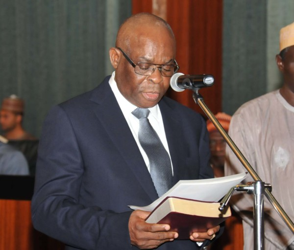 Justice Walter Onnoghen taking oath of office before the Acting President Yemi Osinbajo at the Presidential Villa in Abuja on Tuesday (7/3/17) 01860/6//7/3/2017/Callistus Ewelike/NAN