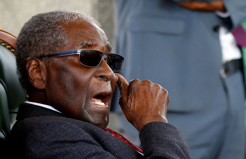 """Zimbabwe's former president Robert Mugabe gestures during a press conference at his private residence nicknamed """"Blue Roof"""" in Harare, Zimbabwe, July 29, 2018. REUTERS/Siphiwe Sibeko"""
