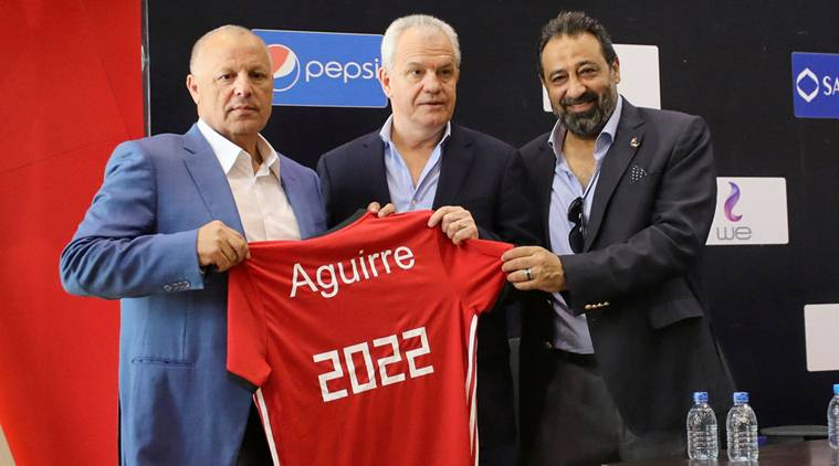 Javier Aguirre, the newly named coach for Egypt's national soccer team, holds a jersey reading 2022 with Egyptian FA head Hany Abo Rida (L) and member of Egypt FA, Magdy Abdelghany (R) in Cairo, Egypt August 2, 2018. REUTERS/Mohamed Abd El Ghany