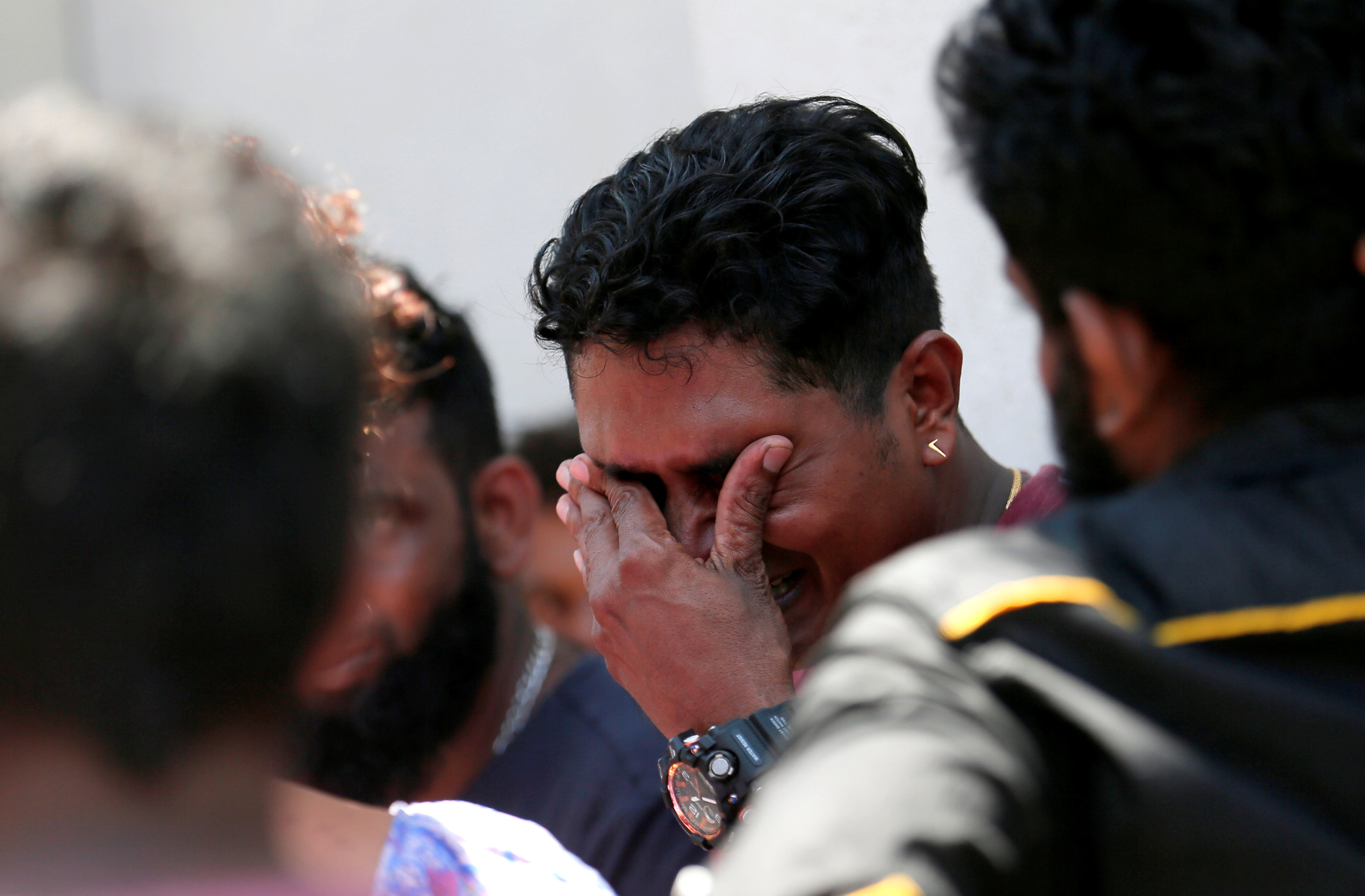 A relative of a victim of the explosion at St. Anthony's Shrine, Kochchikade church reacts at the police mortuary in Colombo, Sri Lanka April 21, 2019. REUTERS/Dinuka Liyanawatte