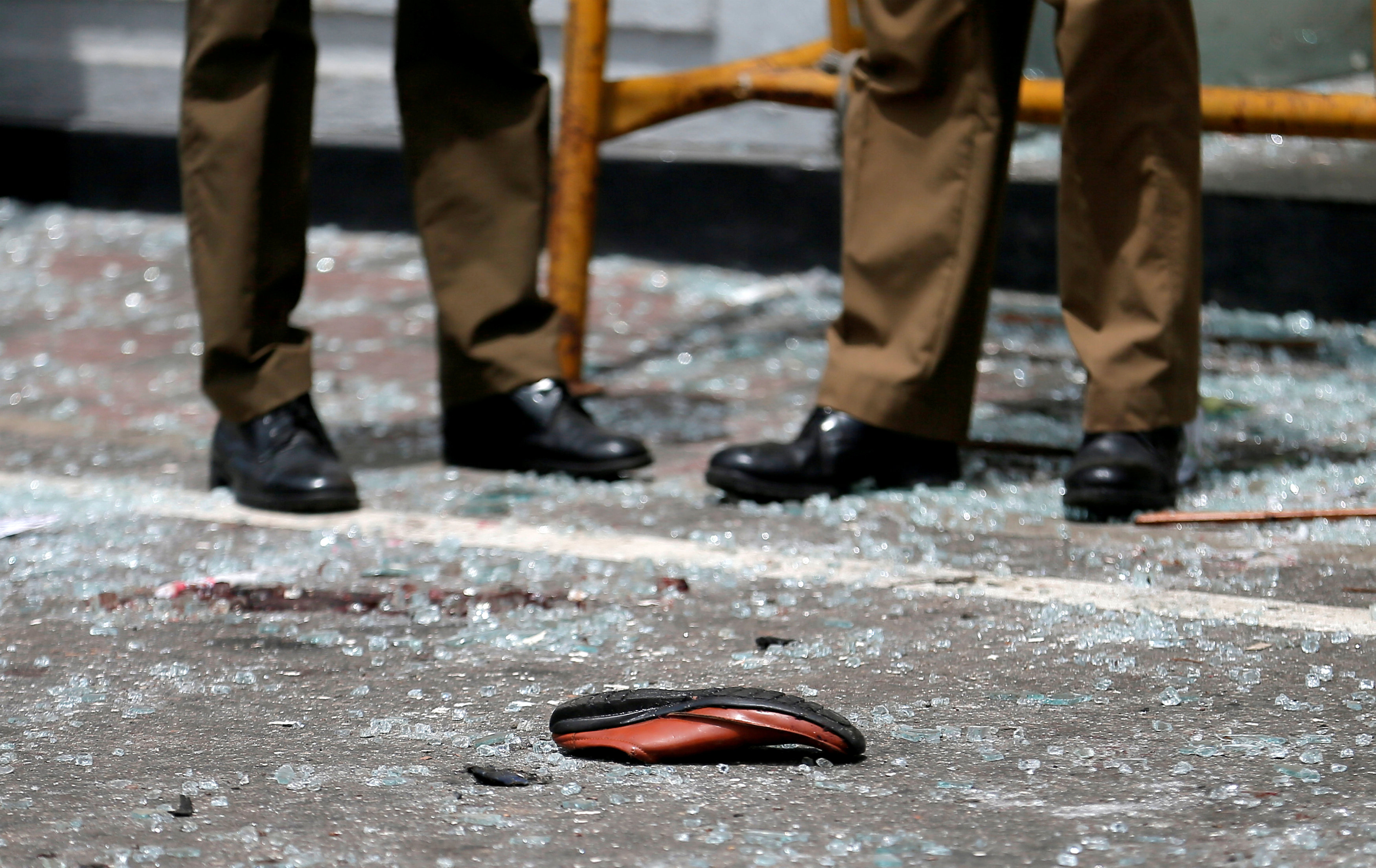 A shoe of a victim is seen in front of the St. Anthony's Shrine, Kochchikade church after an explosion in Colombo, Sri Lanka April 21, 2019. REUTERS/Dinuka Liyanawatte.  TPX IMAGES OF THE DAY
