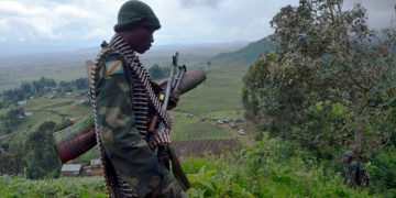 A Democratic Republic of Congo soldier stands on November 5, 2013 on a hilltop outpost in Chanzu in the eastern North Kivu region that was one of the M23 rebels' last stands. Rebels in the Democratic Republic of Congo's powder-keg east surrendered on November 5 after a crushing UN-backed offensive ended their 18-month insurgency in a region that has seen some of Africa's deadliest conflicts. Soldiers and UN peacekeepers sifted on November 6 through the materiel the rebels left behind -- including olive-green rockets allegedly used by the Rwandan military.     AFP PHOTO / Junior D. Kannah            (Photo credit should read Junior D. Kannah/AFP/Getty Images)
