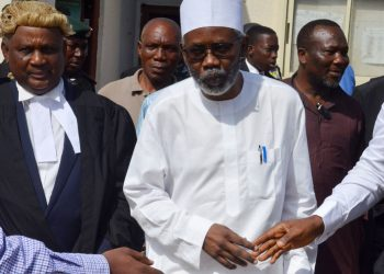 Mohammed Adoke, Nigeria's former attorney general, leaves the Federal High Court in Abuja, Nigeria's capital over financial crimes charges on January 22, 2020. - Nigeria's anti-graft agency said on January 21, 2020, it had filed corruption charges against a former justice minister over a $1.3 billion dollar oil scandal involving international majors Shell and Eni. Mohammed Adoke was arrested last month on arrival from the United Arab Emirates where he had been detained on a Nigerian warrant in connection with one of the West African state's biggest-ever corruption scandals. (Photo by KOLA SULAIMON / AFP) (Photo by KOLA SULAIMON/AFP via Getty Images)
