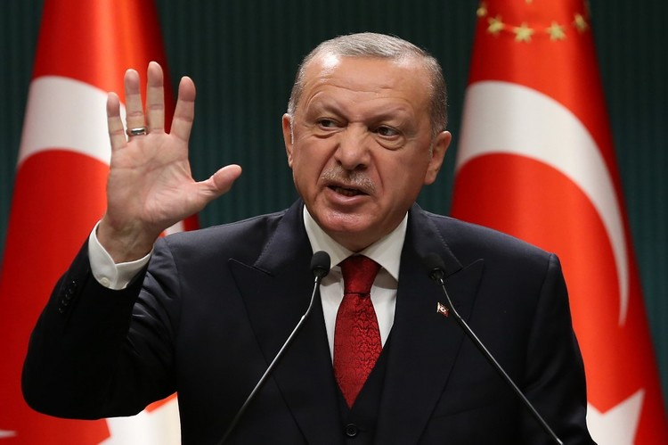 President of Turkey, Recep Tayyip Erdogan gestures as he gives a press conference after the cabinet meeting at the Presidential Complex in Ankara, Turkey, on September 21, 2020. (Photo by Adem ALTAN / AFP)