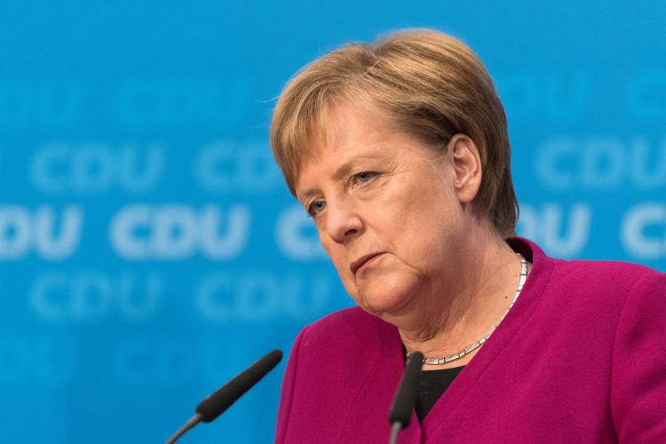 German Chancellor and leader of the Christian Democratic Union (CDU) Angela Merkel looks on during a press conference at the CDU headquarters on October 29, 2018 one day after the regional state elections in Hesse. - German Chancellor Angela Merkel announced she will not stand again as leader of her centre-right CDU, which she has chaired the CDU for 18 years, and step down as German chancellor when her mandate ends in 2021, making way for a successor following a series of regional vote defeats. (Photo by Markus HEINE / AFP)        (Photo credit should read MARKUS HEINE/AFP/Getty Images)