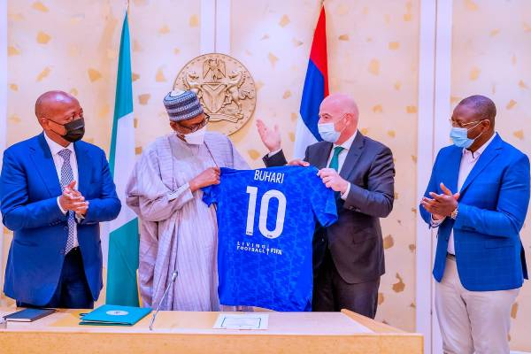 Buhari receives No. 10 jersey from FIFA president